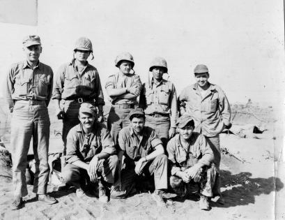 Marines on Iwo. Major Arthur Hanson, the intelligence officer, is standing at left; this is probably the R-2 section.