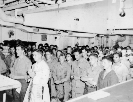 Mass aboard ship, heading for Iwo Jima. January or February 1945.