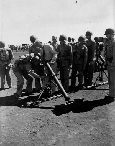 General Franklin Hart inspects an 81mm mortar.