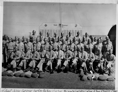 Officers of First Battalion, 24th Marines in 1945. They are seated in front of the regiment's Roll of Honor.