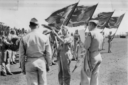 The 4th Marine Division colors receive a fourth campaign streamer for Iwo Jima...