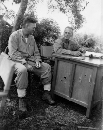 In the field on Saipan. Colonel Franklin Hart – commanding the 24th Marines – has appropriated a proper desk for his field headquarters