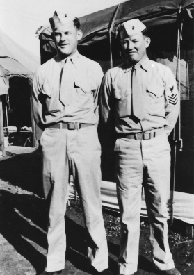 Owen and Floyd Warren. The tents in the background resemble those at Camp Maui; this photo may have been taken near the end of the war.