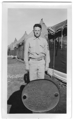 PhM1c Owen, likely taken in 1945. The ID tag was found along with the photographs.