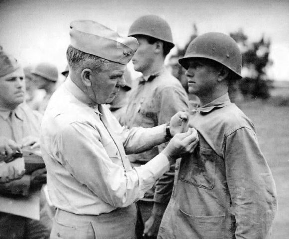 Hendershot receives the Purple Heart from Major General Harry Schmidt. Photo courtesy of Dale Holley.