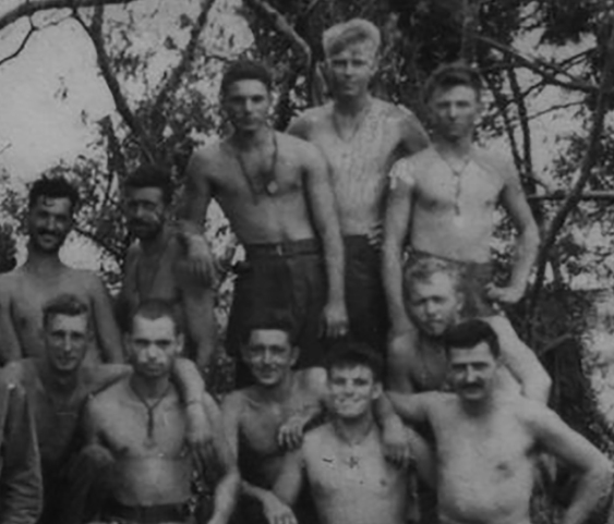 Hendershot (at right in rear row) with Company A on Tinian. Note fresh bandage on his right shoulder. Author's collection.