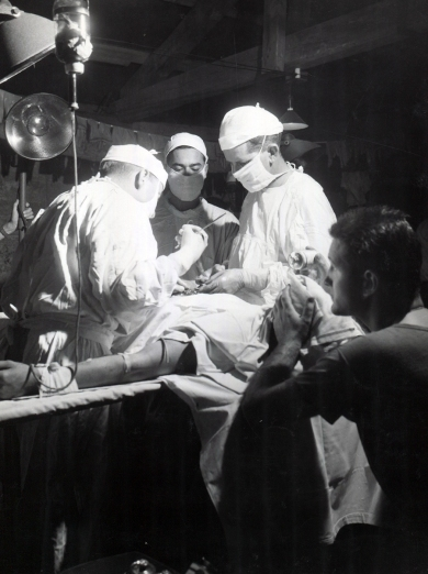 Surgeons treat an abdominal wound in the 4th Marine Division hospital. USMC photo.