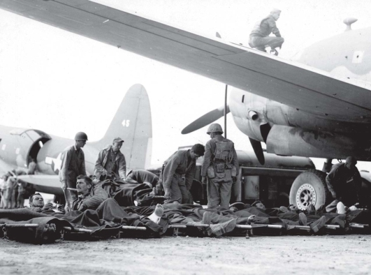 Wounded men wait their turn to board an outbound medevac flight. USMC photo.