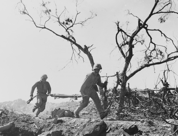 ...followed moments later by a stretcher team. USMC photos by TSgt. Byrd Ferneyhough.
